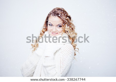 Woman  in  warm knitted scarf and gloves, portrait on  white background, place for your text - stock photo