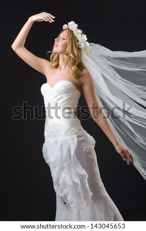 Woman in wedding dress dancing