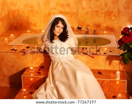 Woman in  wedding dress relaxing in bath tube. - stock photo