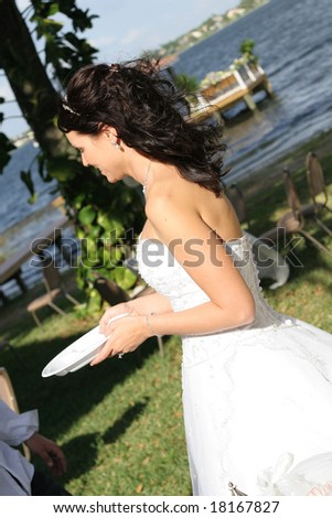 woman in wedding dress with plate - stock photo