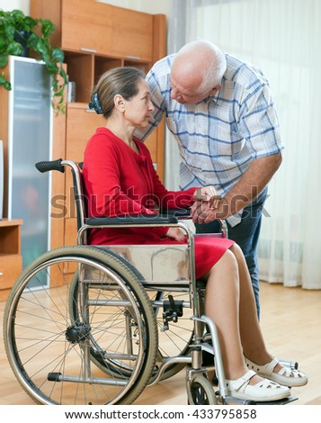woman in   wheelchair and   elderly man in quarrel