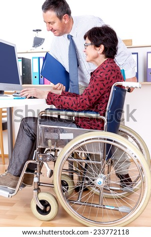 Woman in wheelchair can help in Office - stock photo