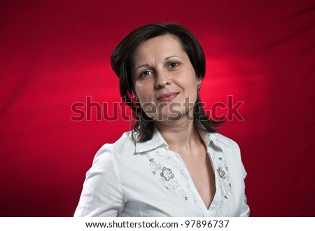 woman in white blouse on red background