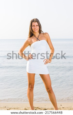 woman in white clothing refreshing at the ocean - stock photo
