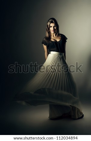 woman in white skirt on wind - stock photo