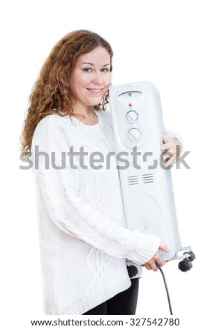 Woman in white sweater with heater in hands on isolated background - stock photo