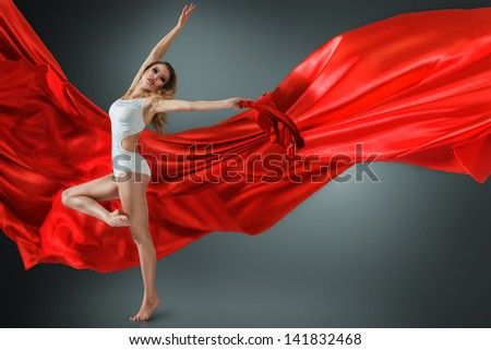Woman in white swimwear dancing with flying fabric