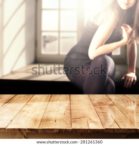 woman in window and table of wood  - stock photo
