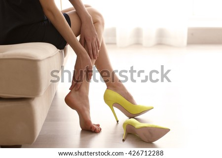 Woman in yellow high heels shoes. - stock photo