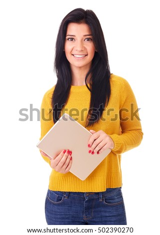 Woman in yellow sweater using a digital tablet, isolated on white