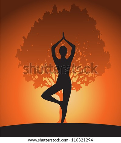Woman in yoga tree pose on sunset. - stock photo