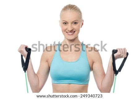 Woman instructor exercising with a resistance band