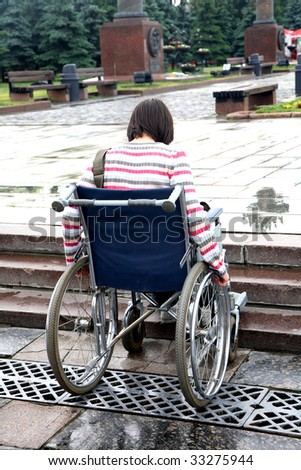 woman -  invalid tries to overcome ladder steps - stock photo