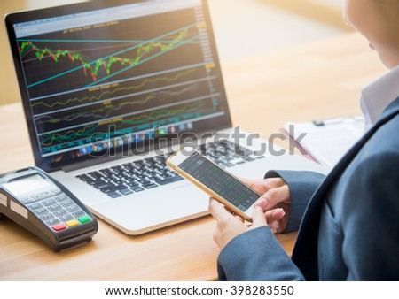 woman investment consultant analyzing company annual financial report balance sheet statement working with documents graphs. Stock market, office, tax, education concept. Hands with smartphone - stock photo
