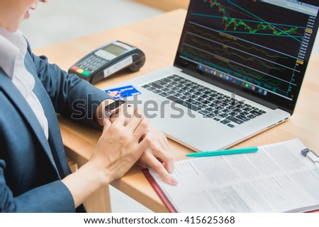 woman investment consultant analyzing company annual financial report balance sheet statement working with documents graphs. Stock market, office, tax, education concept. Hands with watch - stock photo