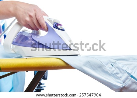 Woman ironed shirt on the ironing board isolated