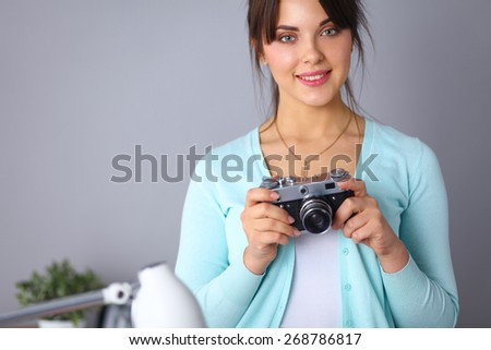 Woman is a proffessional photographer with camera