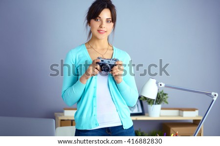 Woman is a proffessional photographer with camera - stock photo