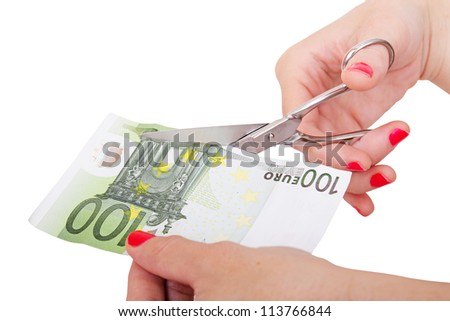 woman is about to cut a euro banknote - stock photo