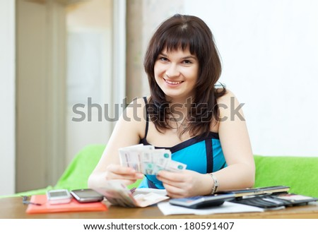 Woman is calculated the family budget at  home