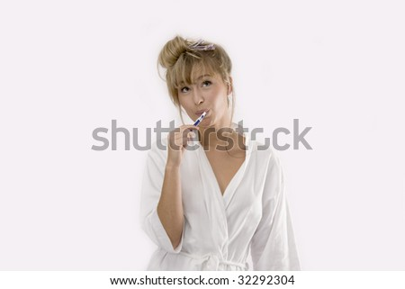 woman is cleaning her teeth