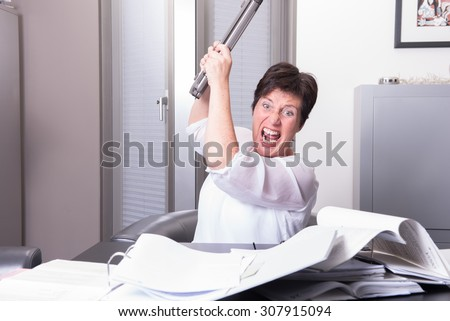 woman is destroying her PC - overworked - stock photo