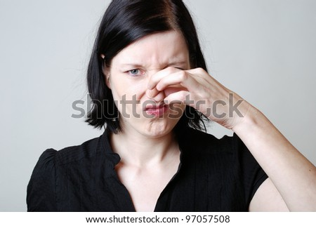 woman is disgusted by the stench