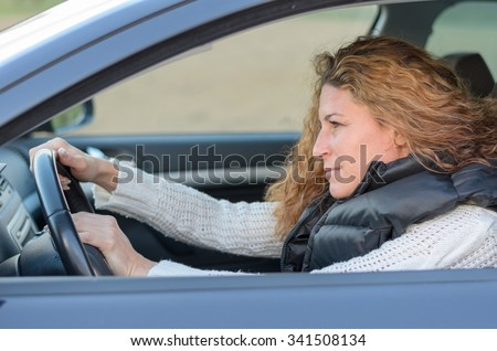 woman is driving her car and pushing the horn