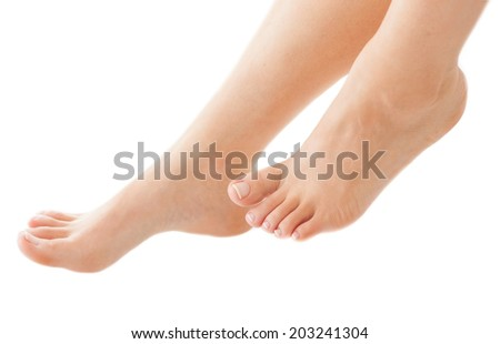Woman is enjoying foot treatment. - stock photo
