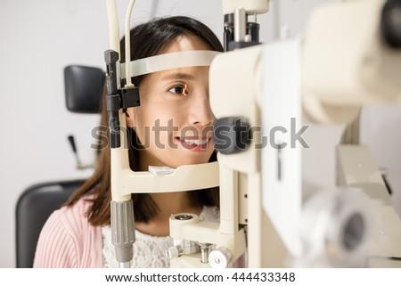 Woman is having eye exam - stock photo