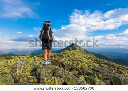 Woman is hiking in Carpathian mountains