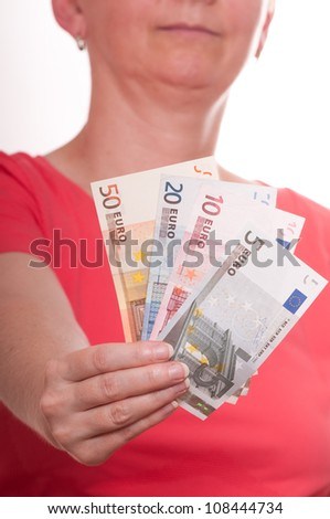 Woman is holding some euro notes in her hand - stock photo