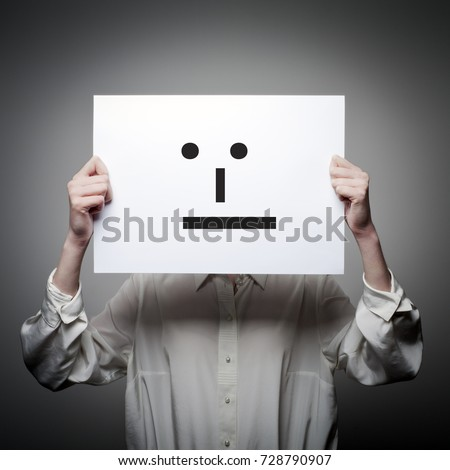 Woman is holding white paper with smile. Whatever and indifference concept.