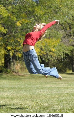 woman is jumping in the park
