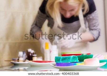 Woman is making a homemade soap, selective focus on foreground