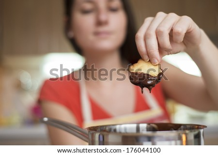 Woman is making christmas cakes in the kitchen - stock photo
