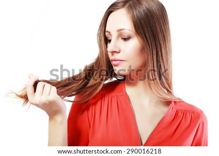 woman is not happy with her fragile hair - stock photo