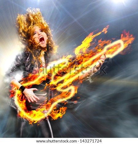 woman is playing rock music on fiery guitar and singing - stock photo