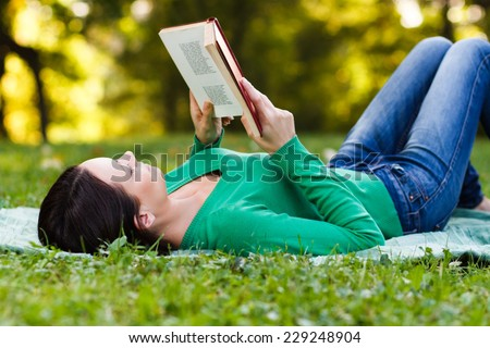 Woman is reading a book and enjoys in her free time,Leisure time - stock photo