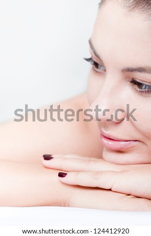 Woman is ready to receive body massage at spa, close up - stock photo