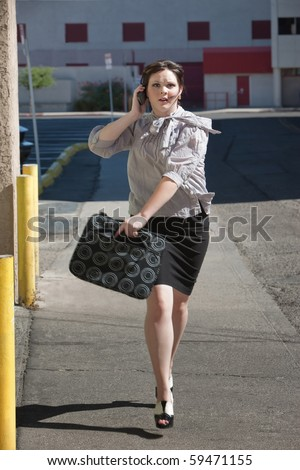 Woman is running down street late for meeting. - stock photo