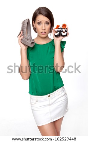 Woman is sad as she has to decide between career or her wish to become pregnant - stock photo