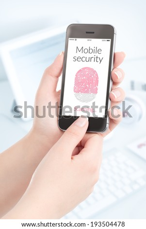 Woman is scanning fingerprint by modern smartphone. Mobile security concept. - stock photo