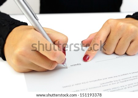 woman is signing contract - stock photo