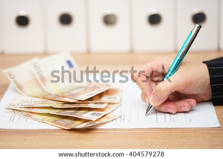 woman is signing contract to get a lot of money - stock photo