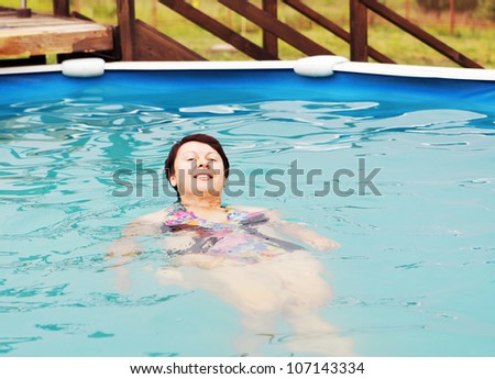 Woman is swimming in a pool