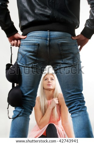 Woman is trapped by her aggresive boyfriend. - stock photo
