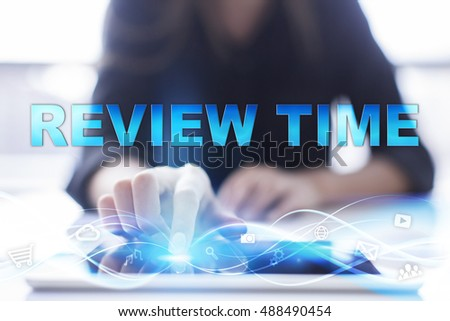 "Woman is using modern tablet pc, presssing on touch screen and selecting ""Review time""."