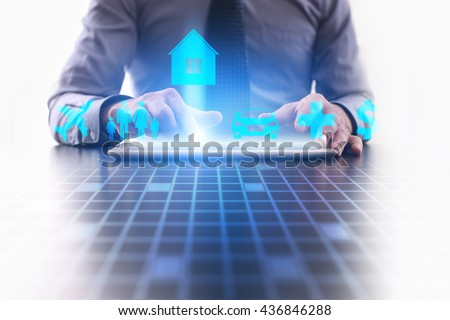 Woman is using tablet pc and selecting a kind of insurance. home insurance. - stock photo