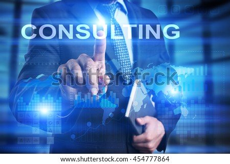 "Woman is using tablet pc, pressing on virtual screen and select ""Consulting"". - stock photo"